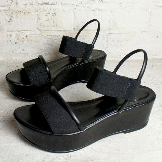 """<B>Elastic+strap+over+vamp.</B> A+versatile,+easy+to+wear+platform+sandal+that's+perfect+for+your+vacation+wardrobe.+ <P><BR><B>Heel+height:+2.25+inches+Toe+height+:+1.25+inch+(platform)</B> <br><br><i>Please+click+""""View+Sizing+Guide''+link+to+access+product+specifications,+fit+tips+&+sizing+conversion+information.</i>"""