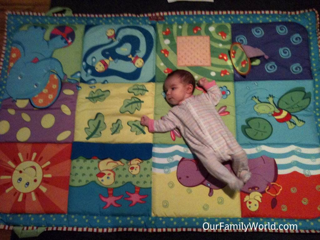 Baby in a Tiny Love Super Mat