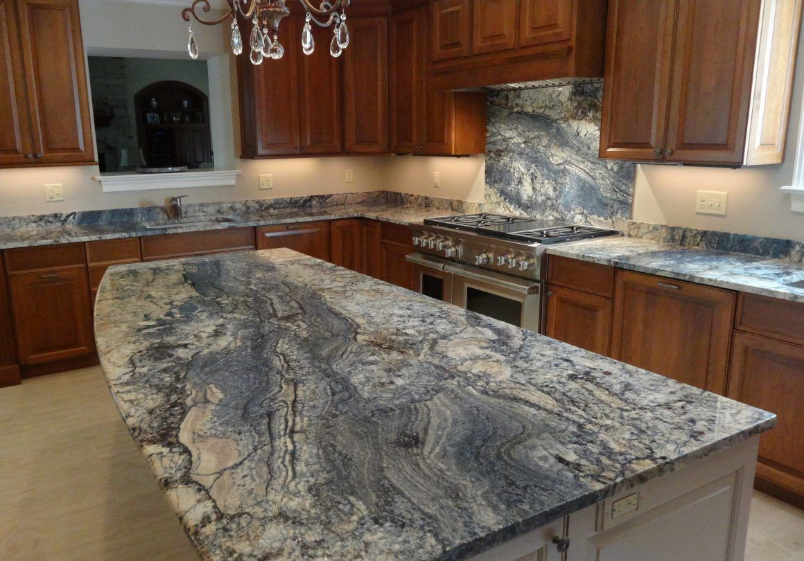 Why Does This Kitchen Island Make Us Want To Go Swimming We Re In Love Blue Granite Countertops Granite Countertops Kitchen Granite Kitchen