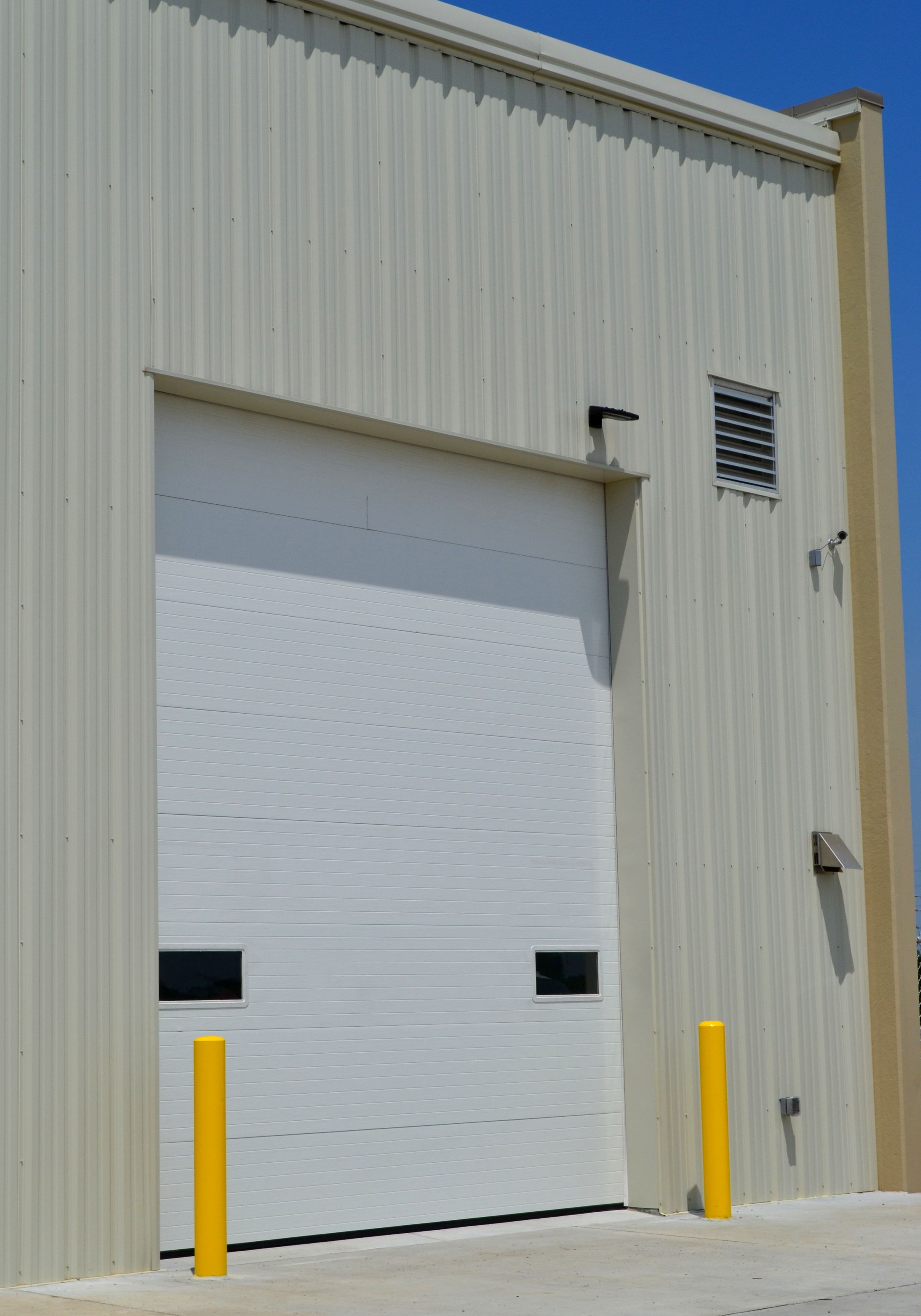 Wayne Dalton Of Central Iowa Is A Privately Owned Garage Door Company Servicing Des Moines West Des M Garage Doors Commercial Garage Doors Garage Door Company