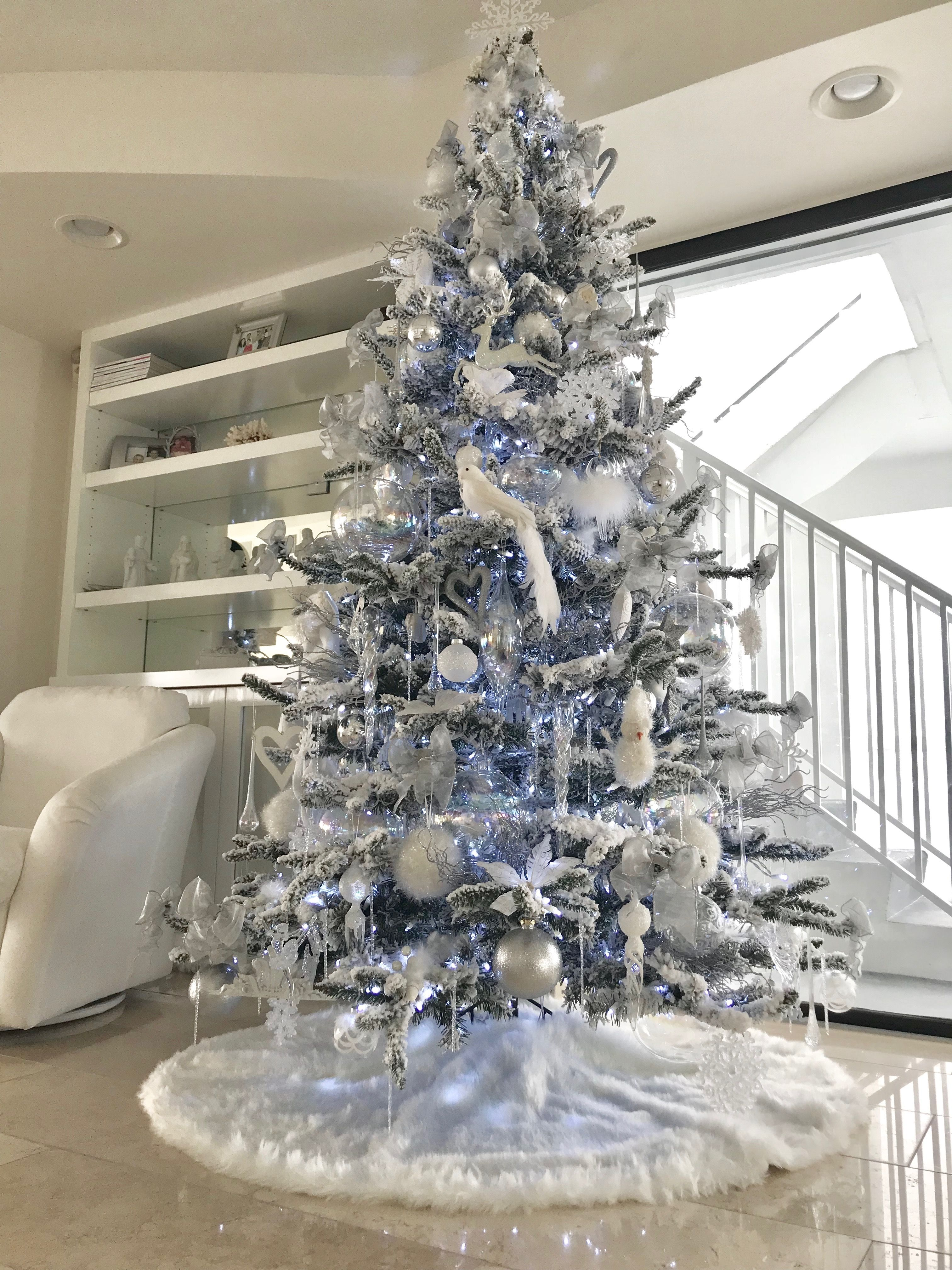 Flocked All White Clear And Silver Christmas Tree By Rachel Pihakis Of Pathfind Luxury Christmas Tree White Christmas Tree Decorations Elegant Christmas Trees