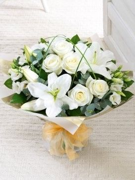 Falkirk flowers falkirk flower delivery by local florists offering wonderfully white hand tied this is a very elegant contemporary hand tied bouquet groups of crisp white flowers are beautifully framed by loops of mightylinksfo