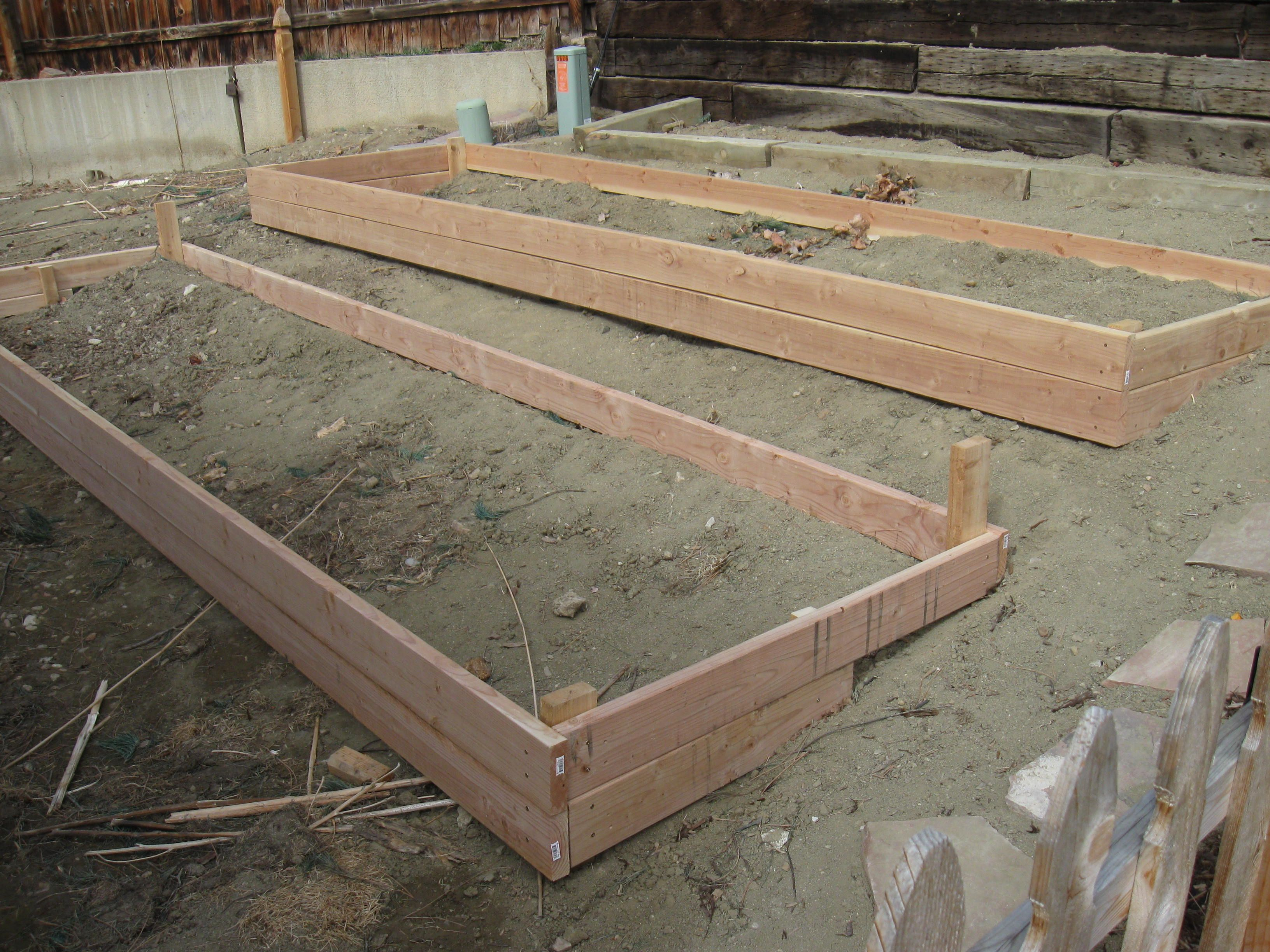 raised garden beds on slope with a bit more room in between for