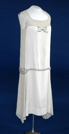 1926 Wedding dress of cream silk/satin crepe and cream lace over pale peach silk, trimmed with diamante, pearls, silver beads and silver lace.