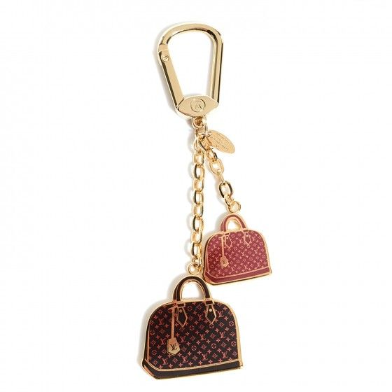 This is an authentic LOUIS VUITTON Iconic Alma Bag Charm. This endearing key holder is crafted of enamel with gold trim, in the shape of the iconic Alma handbags in the Vernis line.
