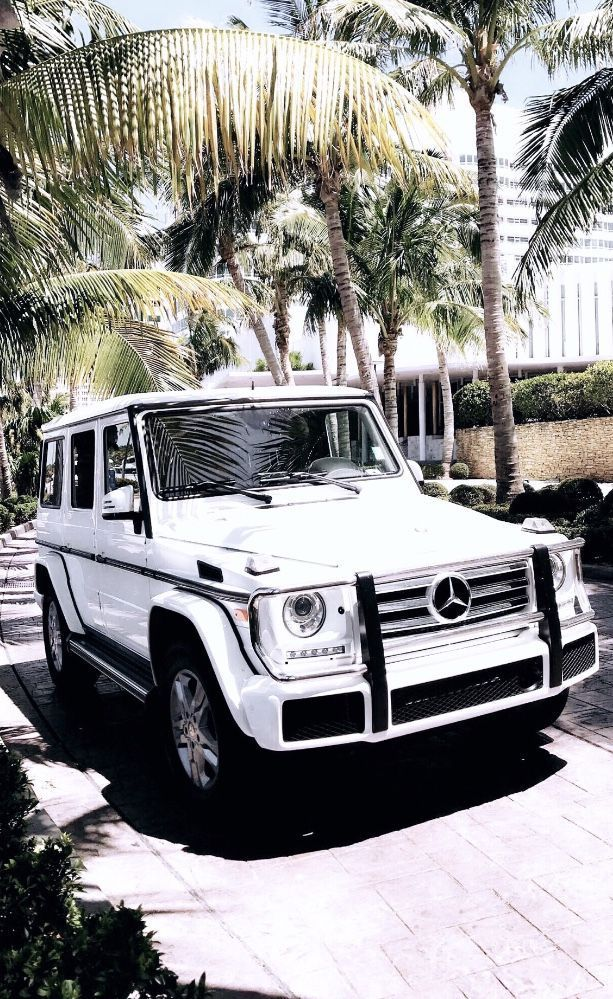 My dream car : a beautiful white Mercedes Benz G Wagon (w/ red interior)!