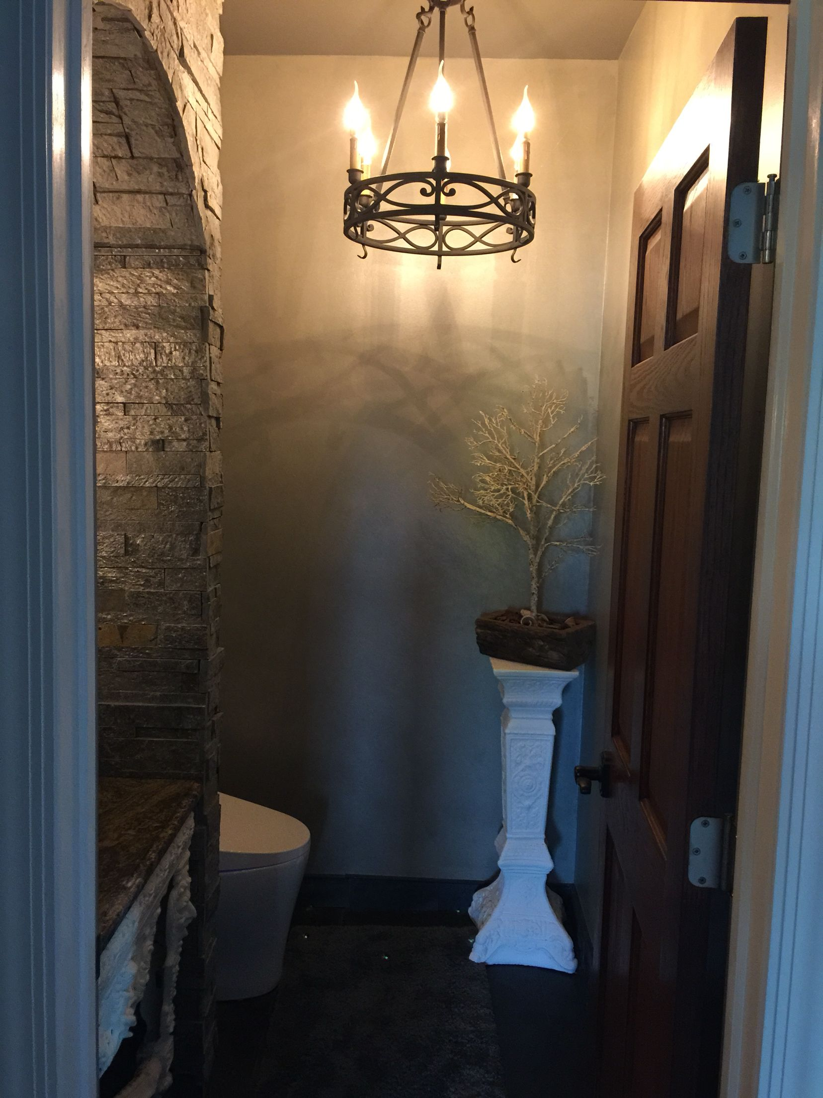 Bathroom Lights Rusting powder room - entrance to our old world castle bathroom with