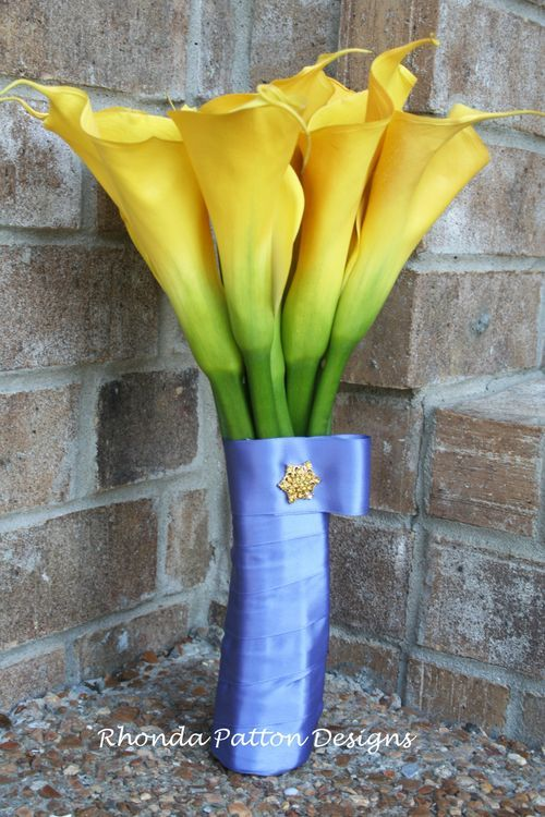 Beautiful Blue and Gold bouquet!  Yellow Calla Lilies and cornflower blue ribbon.