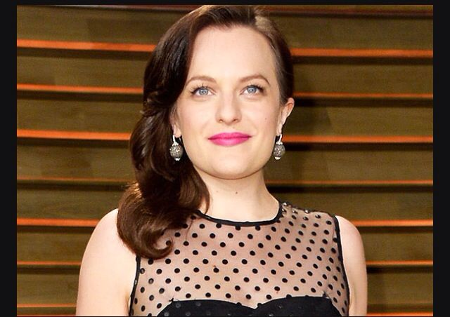 elisabeth moss in a soft neutral sweater with a touch of