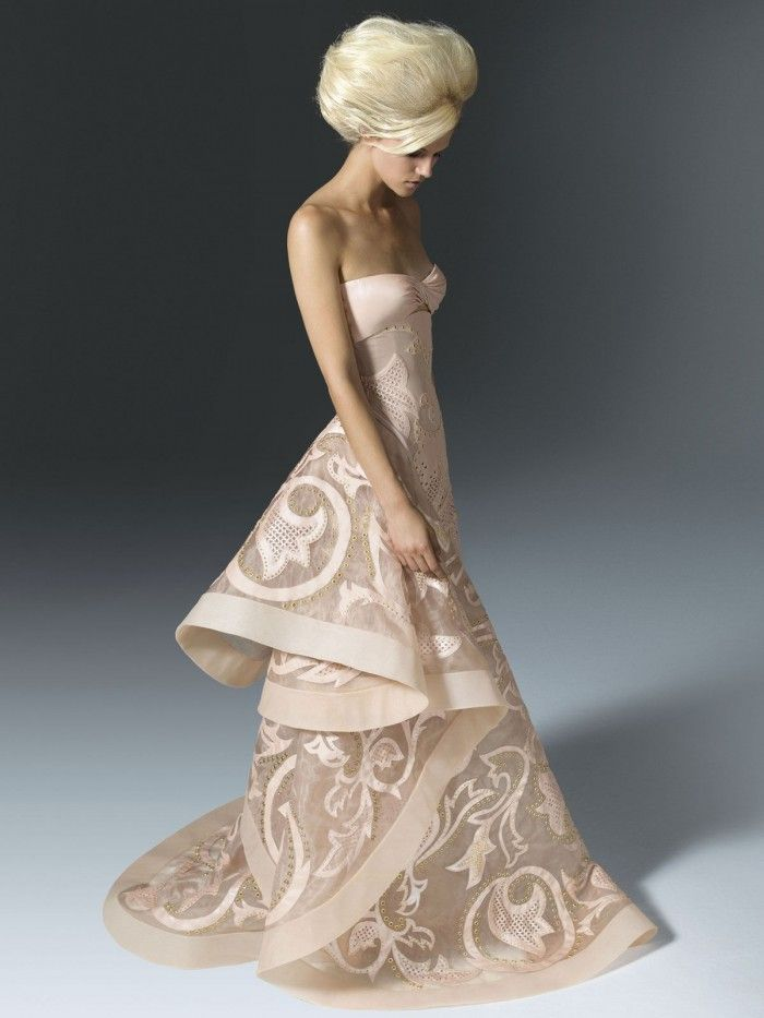 Versace.. she looks like a barbie doll.. this dress is to die for ...