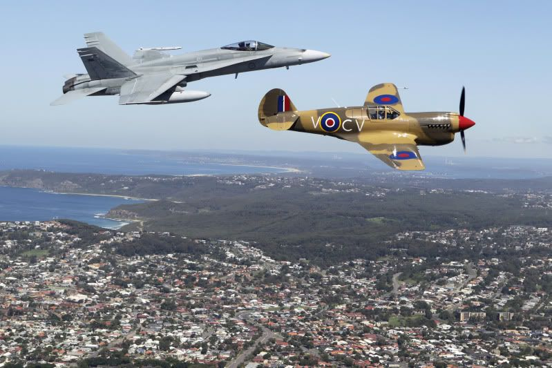 A Royal Australian Air Force F/A-18 Hornet and a World War II Kittyhawk take to the sky's over Newcastle during the No 450 Squadron 70th Anniversary celebrations.