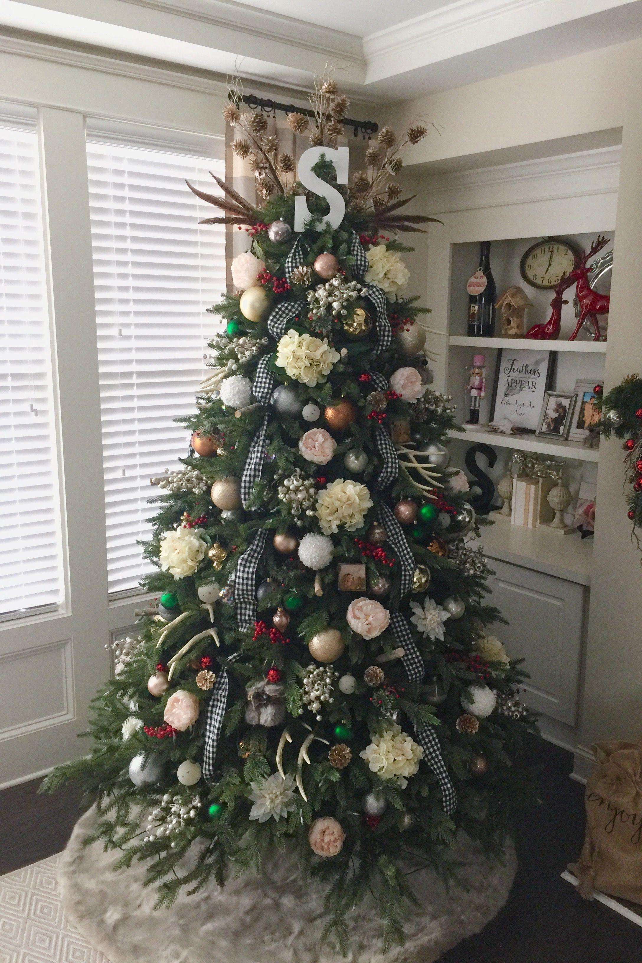 Modern rustic Christmas tree decorated. Fur, Flowers