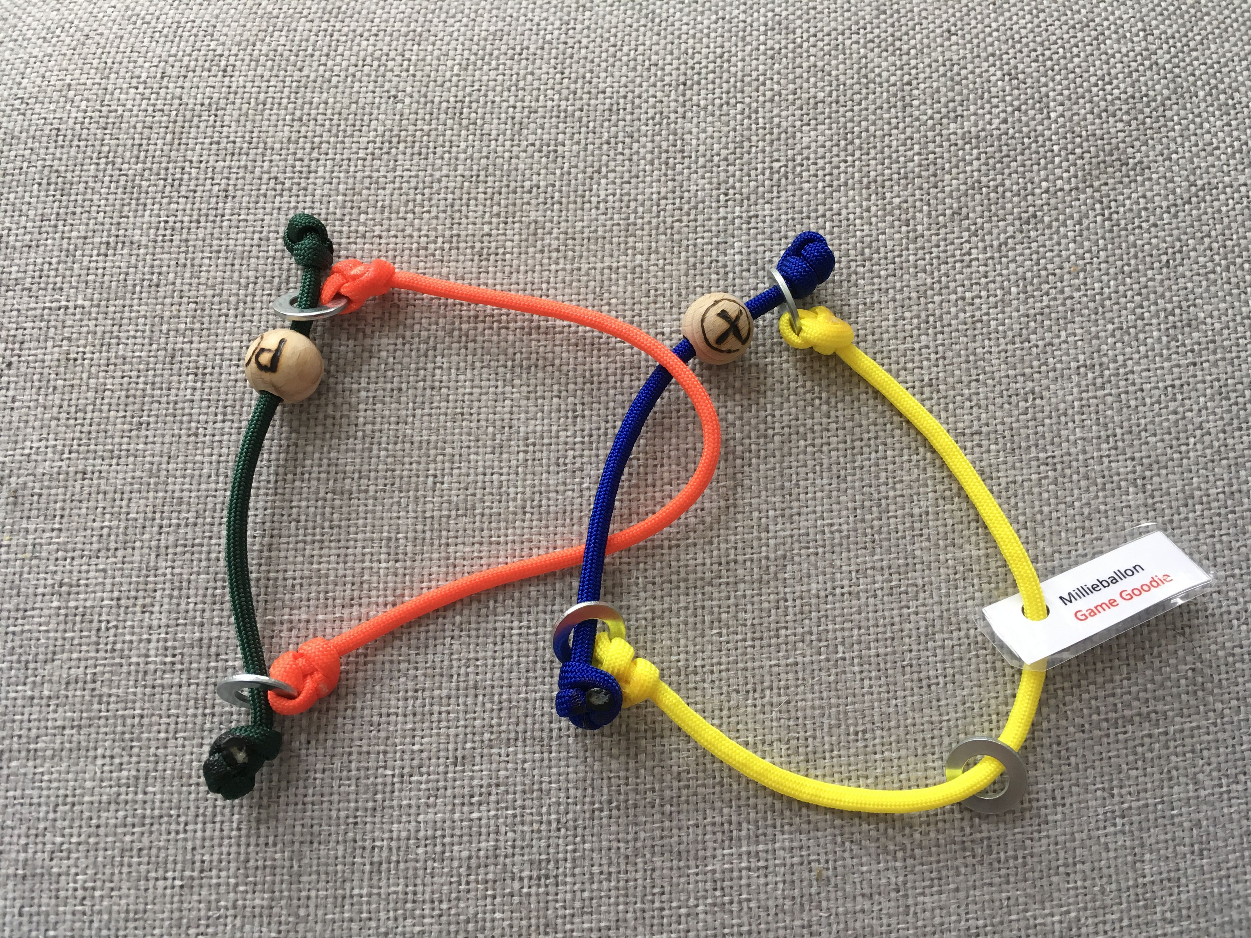 Game goodie. Puzzle adaption, paracord and wooden beads with ...