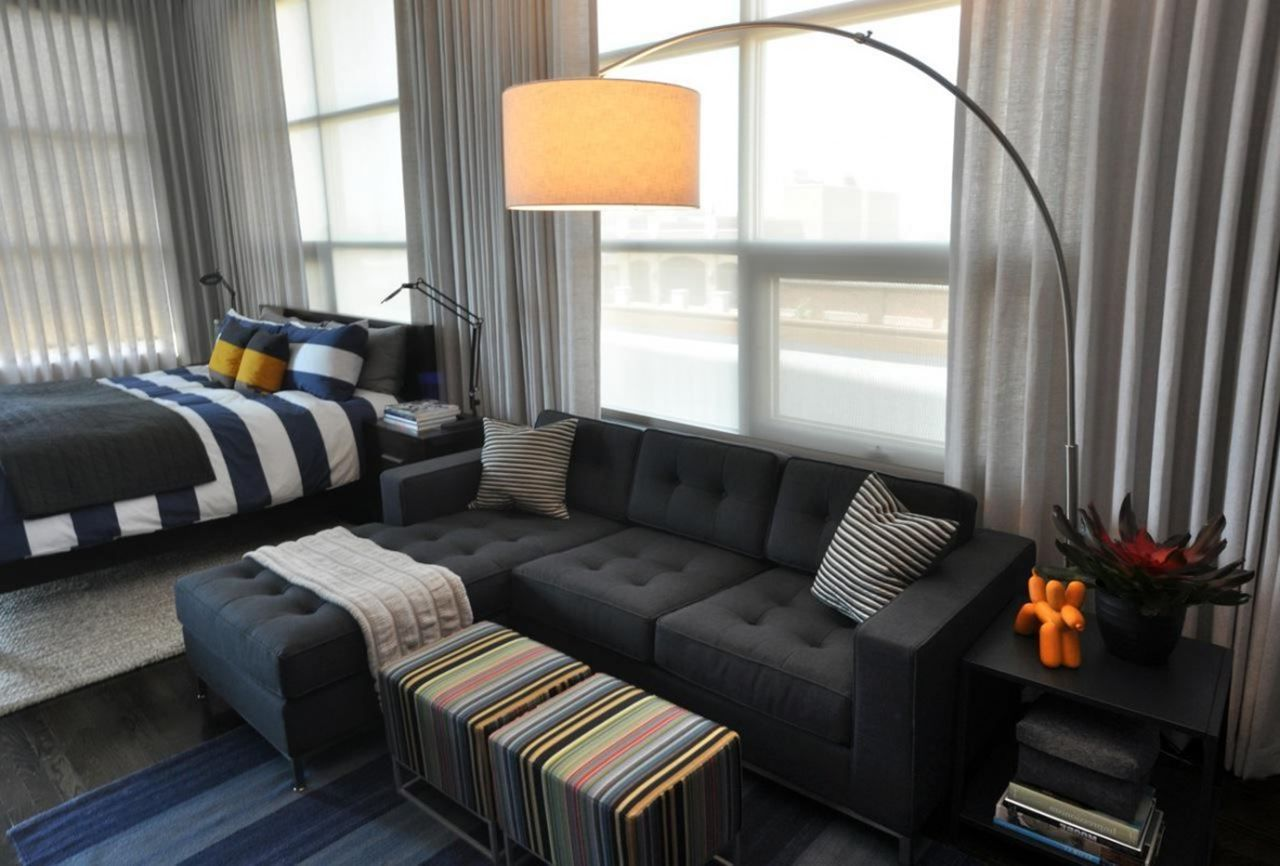 living room furniture for studio apartments small interior design pictures apartment unusual space with l shape dark grey bed sofa and drum sahpe standing lamp decor idea choosing