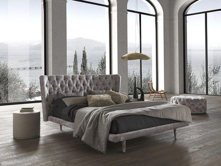 Camera da letto grigia ideale per chi ama lo stile moderno ma
