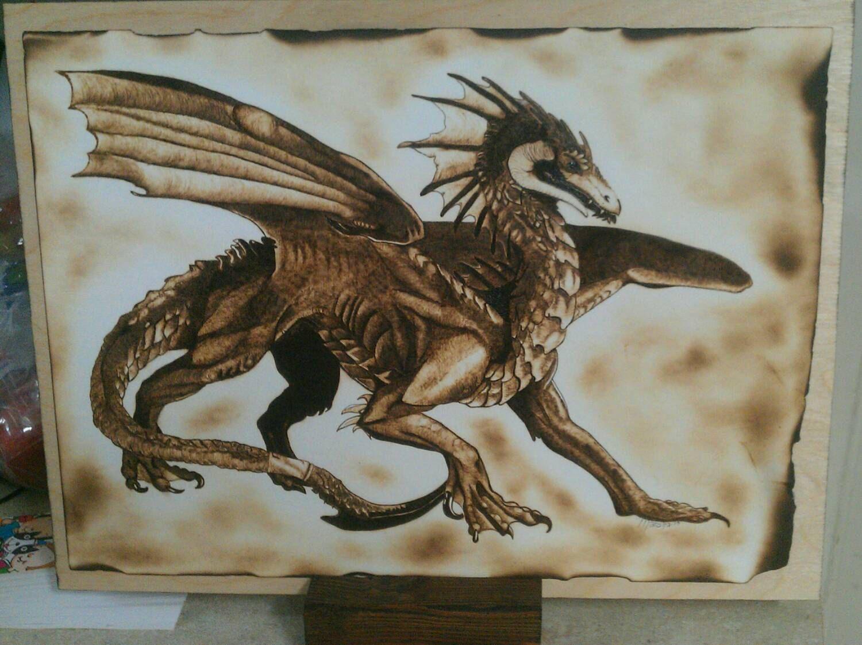 Woodburn art dragon percival the fierce burning on paper