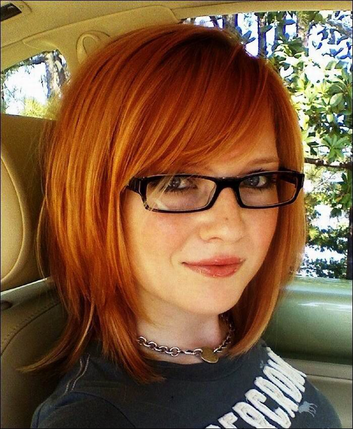 Medium length layered fine red hair with bangs
