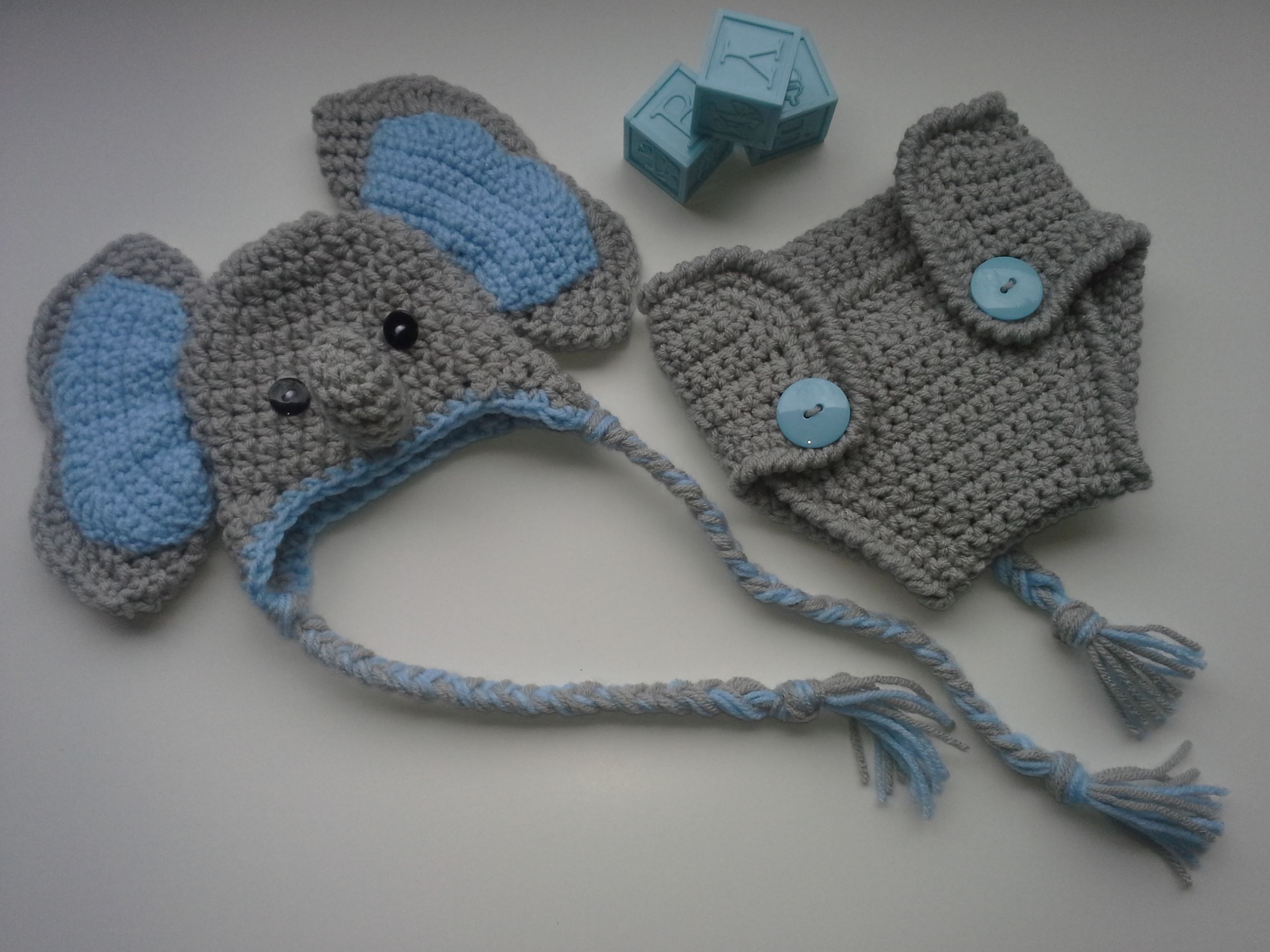 c8e8721f19d This is a handmade Elephant hat with diaper cover. There are 2 buttons on  the