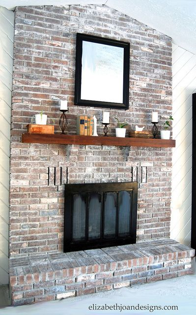 Whitewashed brick and Brick fireplace