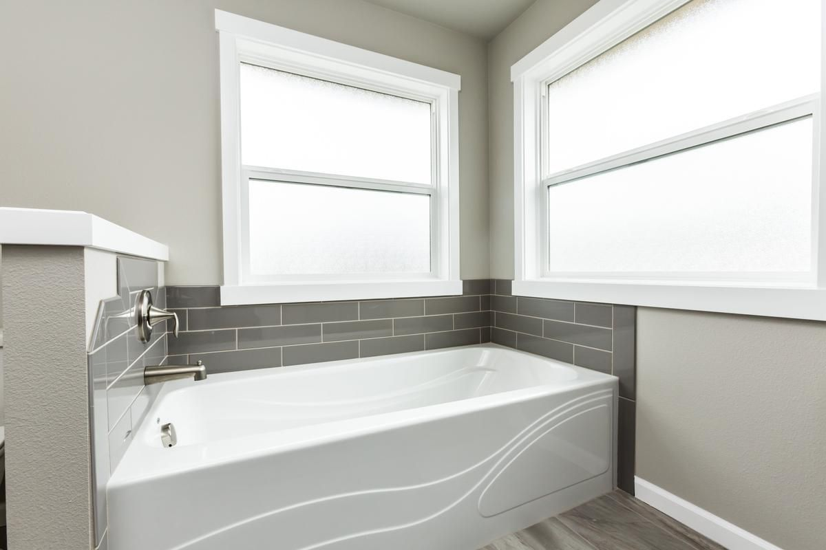 An example of the master bath slide-in tub with subway tile back ...