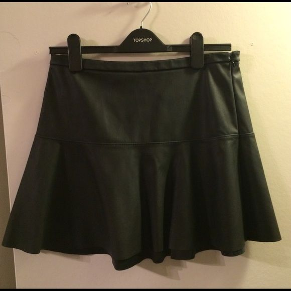 "Black Faux Leather Skirt Sits on the waist, 16"" long, 30"" around the waist Express Skirts"