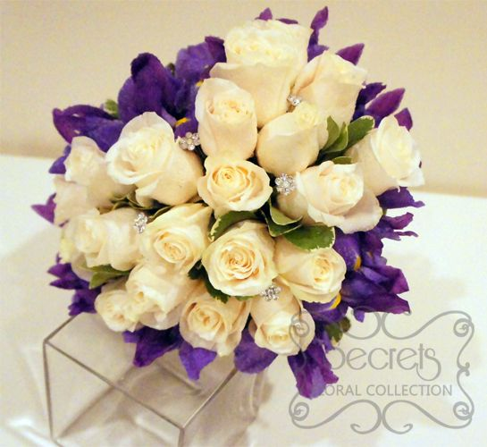 Fresh Cream Roses Purple Iris And Pittosporum Heart Shaped Bridal Bouquet With Swarovski Crystal Jewel Picks Top View