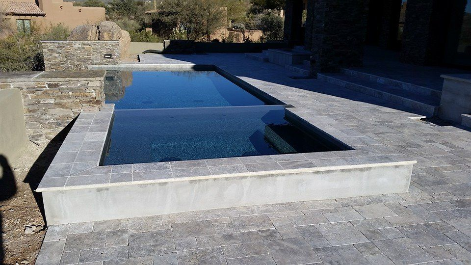 Silver travertine pavers were used to design this pool ... on Travertine Patio Ideas id=70087