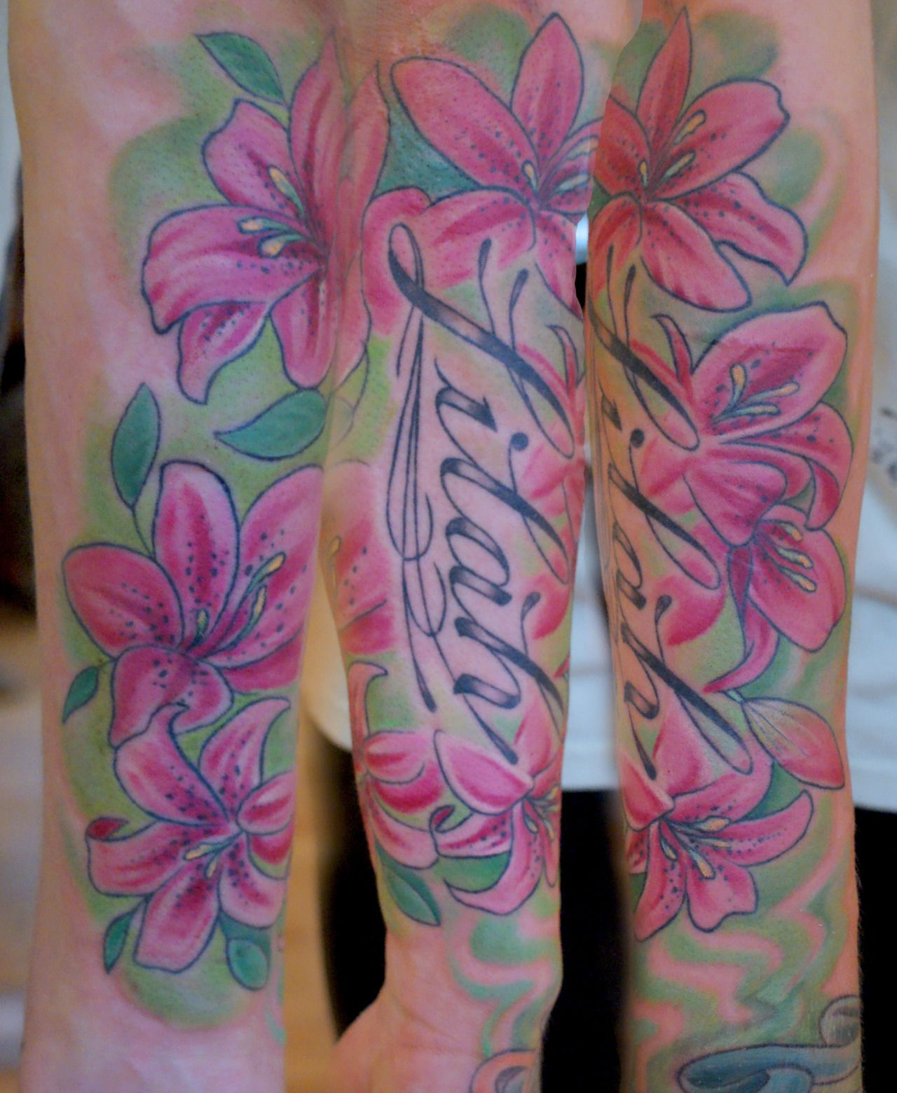 27 astounding lily flower tattoos creativefan tattoos 27 astounding lily flower tattoos creativefan izmirmasajfo Gallery