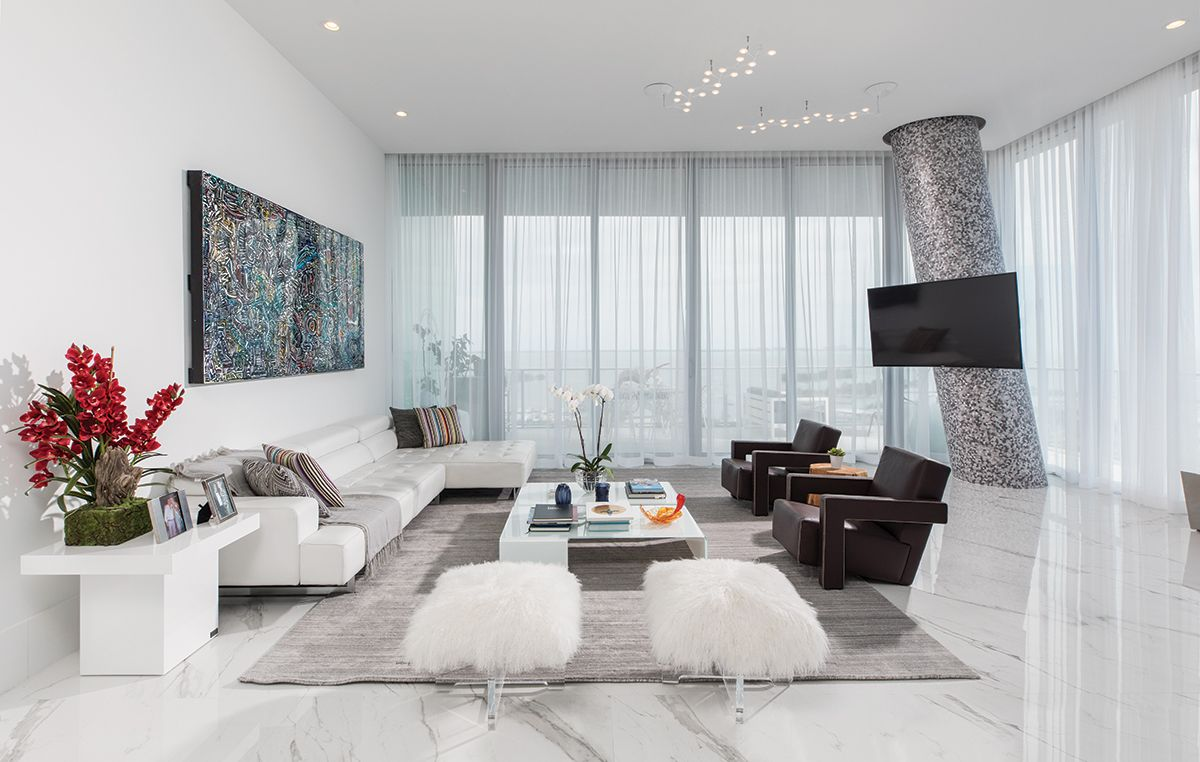 Cassina S Chocolate Hued Lounge Chairs Join A White Leather Sofa And Jonathan Adler S Lu Lounge Chairs Living Room White Dining Room Chairs White Leather Sofas #white #leather #living #room