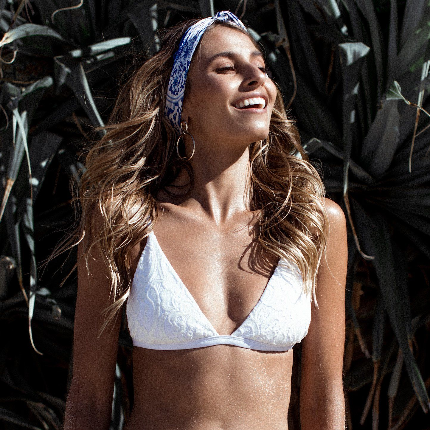 The Tula lace bikini top is a summer staple. Triangle bikini design features beautiful feminine white lace with adjustable straps and back clasp closure. Check out our website for more! #beachday #eteswimwear #bikini #summer #summerromance