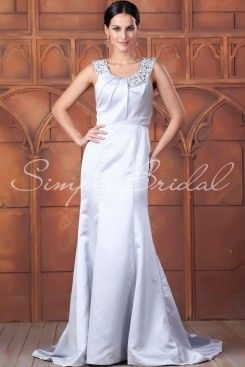 Wedding Dress by SimplyBridal. The Alicia gown is a beautiful statement piece. The princess lines elongate the figure and make this a great option for petite and full figure brides. The scooped neckline is exquisitely adorned with beading for a pop of sparkle. This is a great option fo. USD $649.99