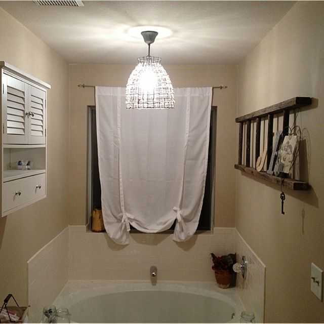 Husband just posted his first blog post on how to change a plug in light to a sconce style chandelier.