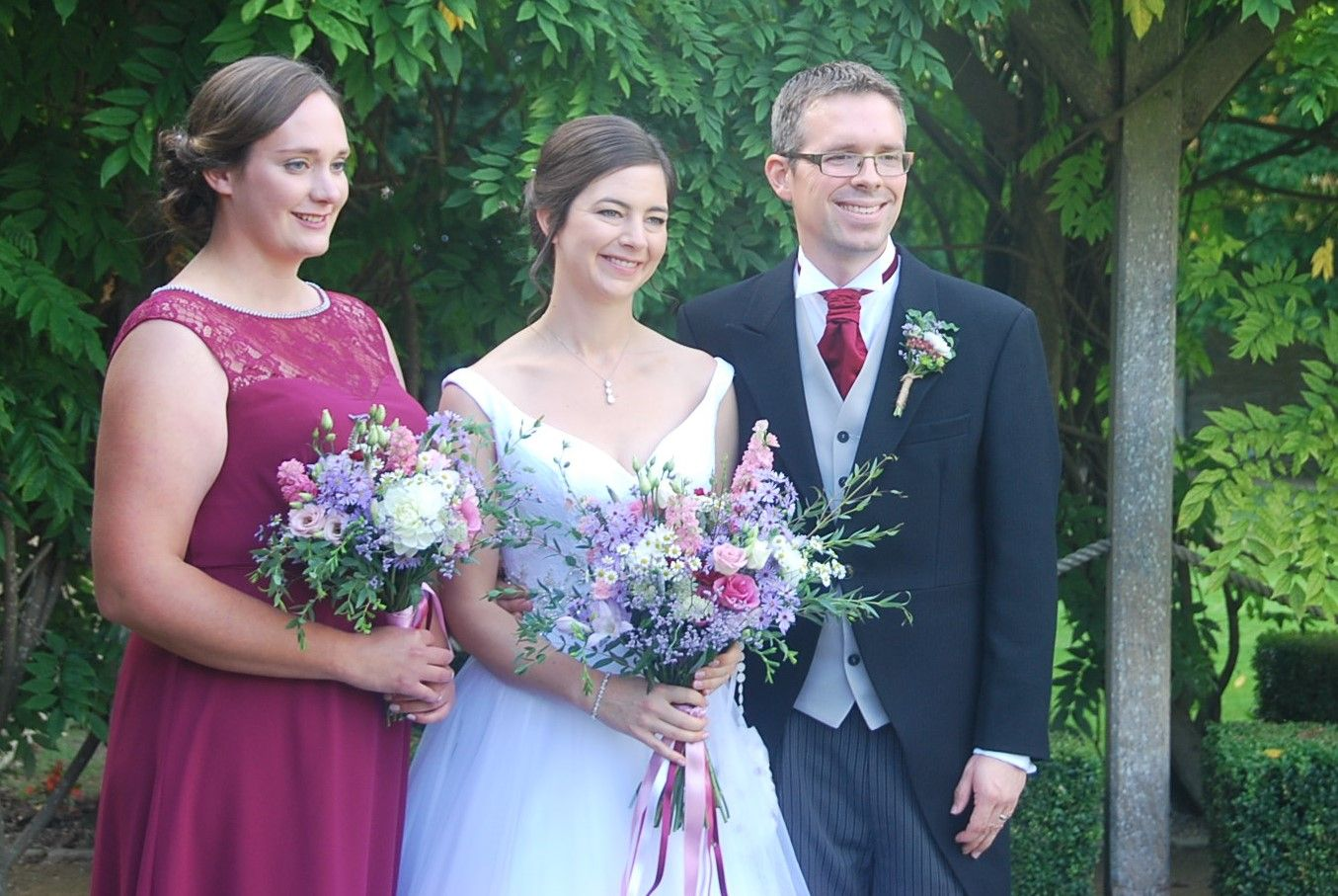 Bridal party - very many congratulations and good wishes for the future. Flowers by Honey Pot Flowers.  Venue The Tythe Barn, Bicester . Photo courtesy of Sarah Preston