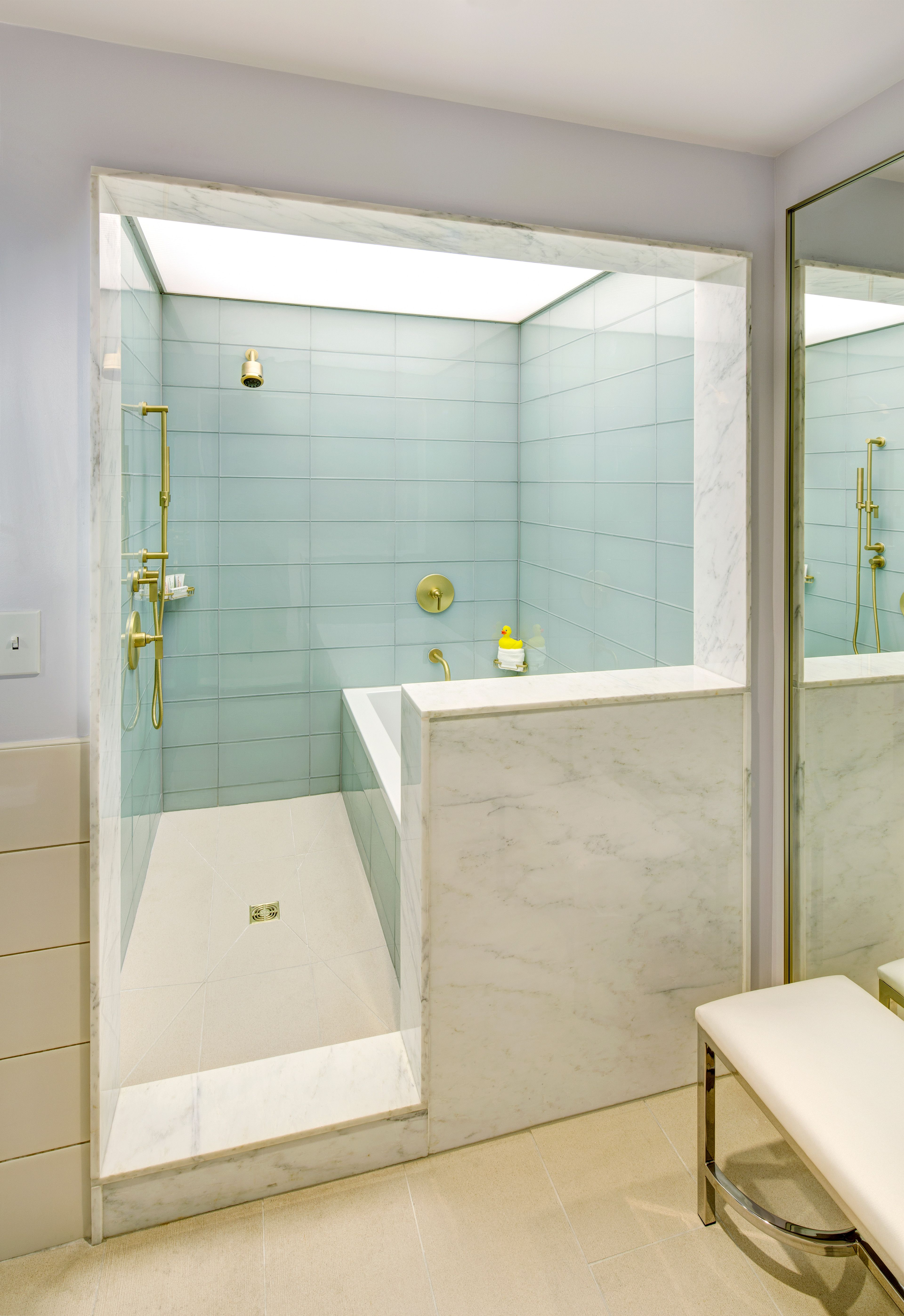 The spacious bathroom features a wet room with a tub and ... on Wet Room With Freestanding Tub  id=85375