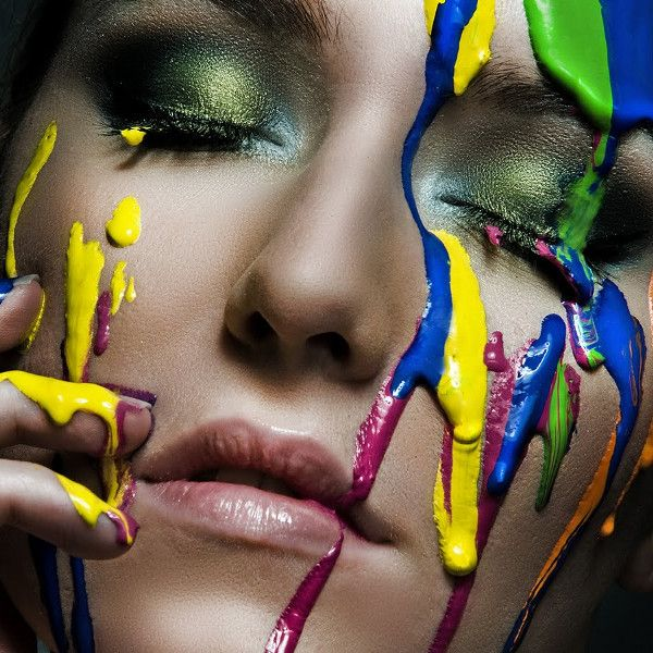 Paint dripping on her face