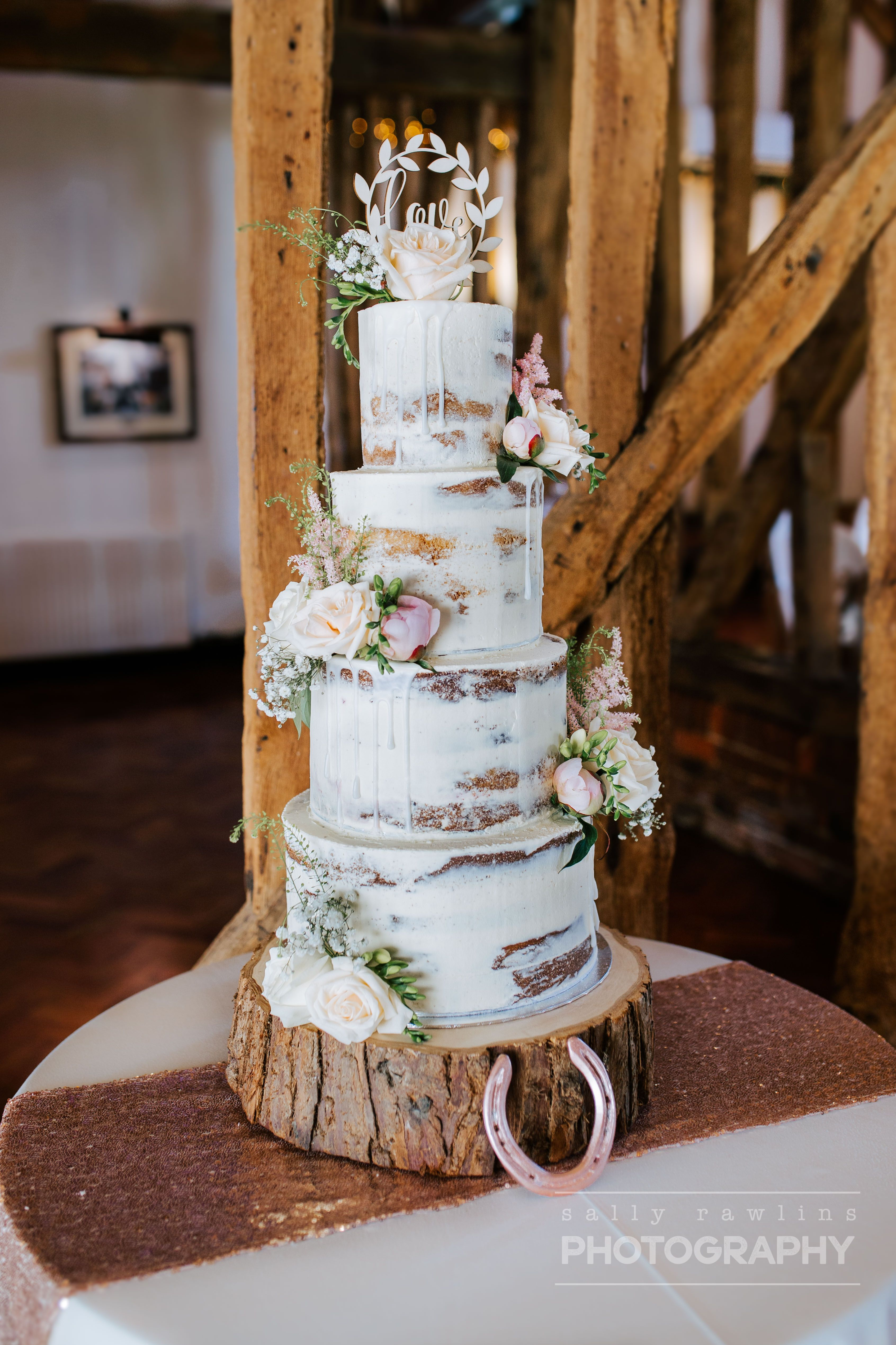 Another gorgeous seminaked rustic four tier wedding cake made by