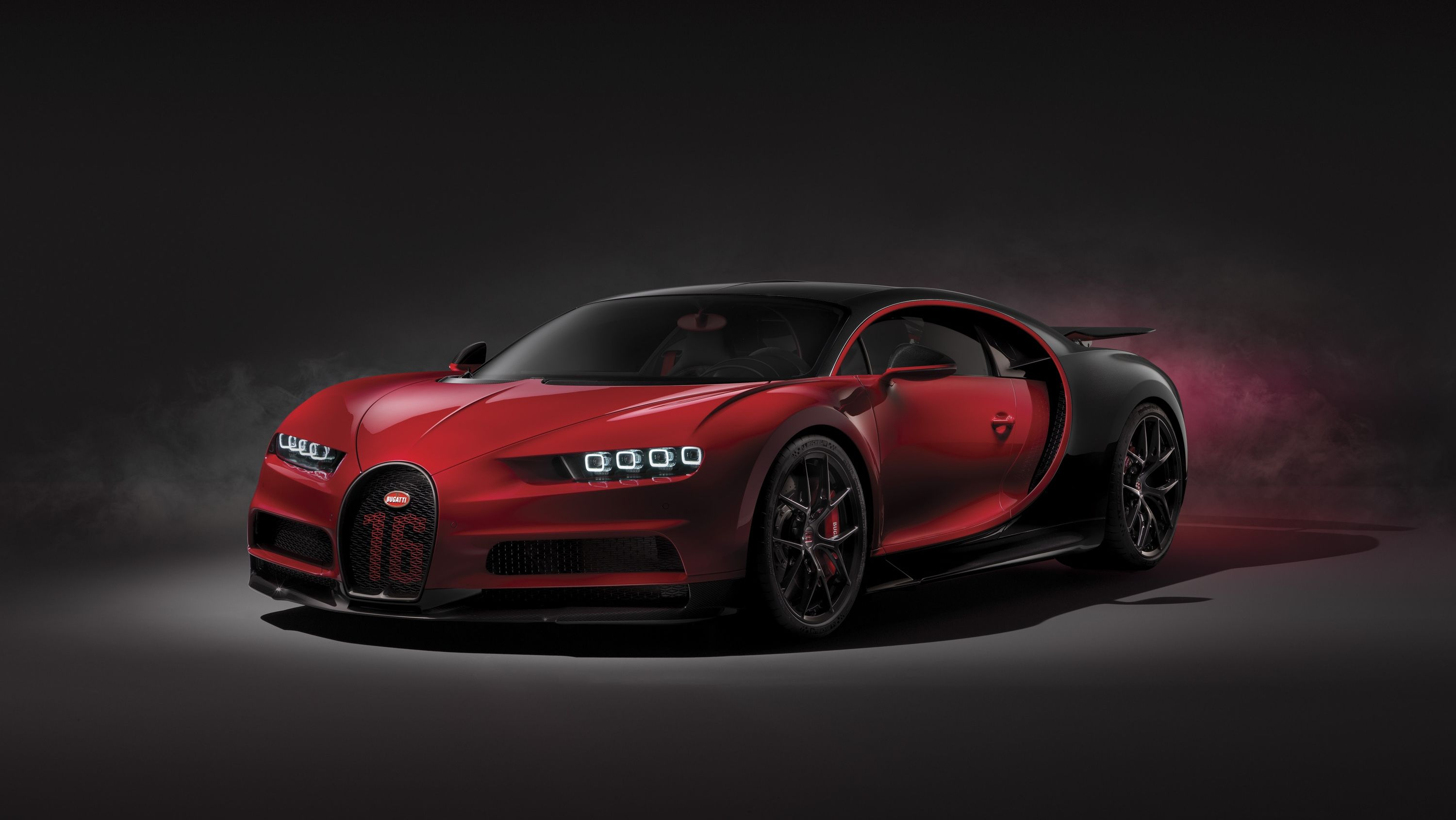 The Buggati Chiron Sport Weighs Less Gets Carbon Fiber Wipers And A New Exhaust Layout Costs An Extra 1 Million Top Speed Bugatti Chiron Sport Bugatti Chiron New Bugatti Chiron