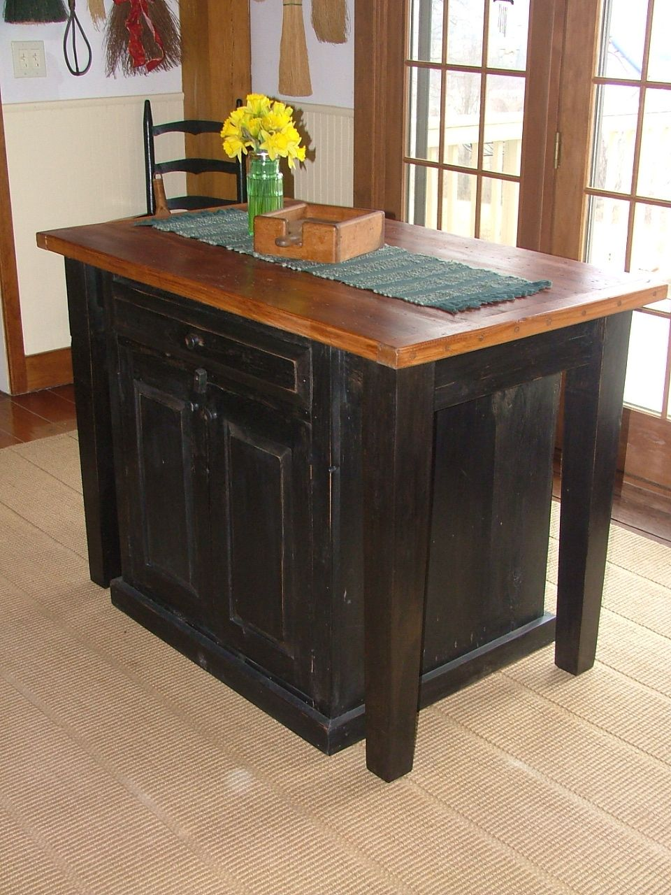 barn wood kitchen island with tapered legs and open end