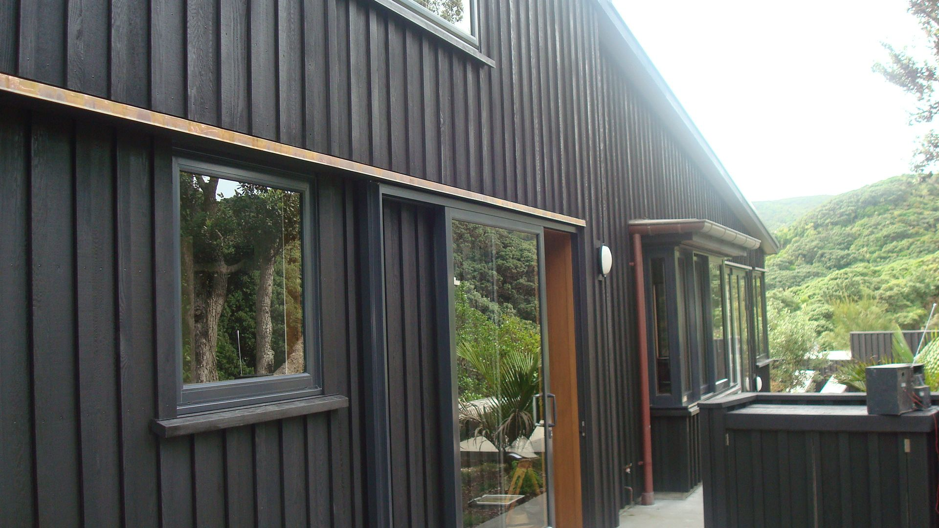 Board and Batten with resene stain Piha Dark on dark House