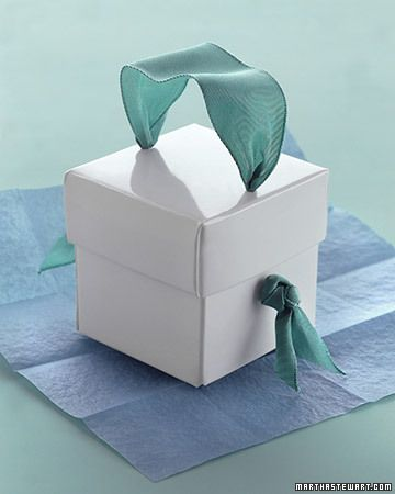 Ribbon Handle. Thread a wide ribbon through the lid and sides and secure with knots for a decorative handle on a gift box