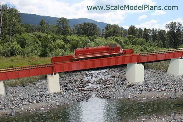 Plate girder bridge with deck girder bridge approaches