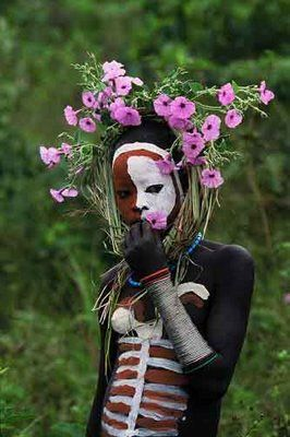 """""""Over a period of 6 years, renowned photographer Hans Silvester photographed peoples of the Omo Valley. It is a very remote area in Ethiopia. Wild and unspoiled. The Surma and Mursi Tribes take great pleasure in decorating themselves with the glorious pigments available in this volcanic region."""""""
