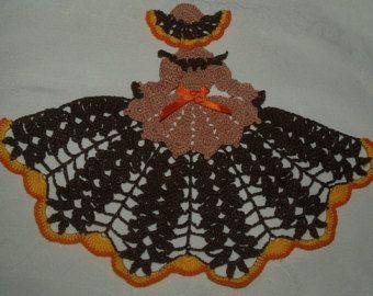 Bruja de Halloween con cráneos en tapete de vestido de por vjf25