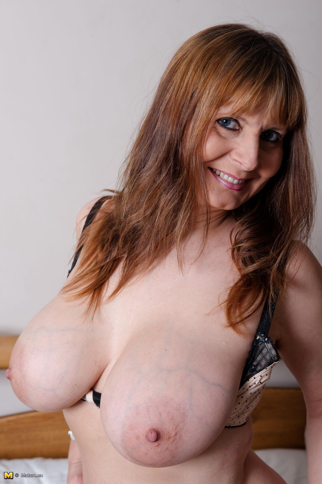 The mature massive round boobs naked