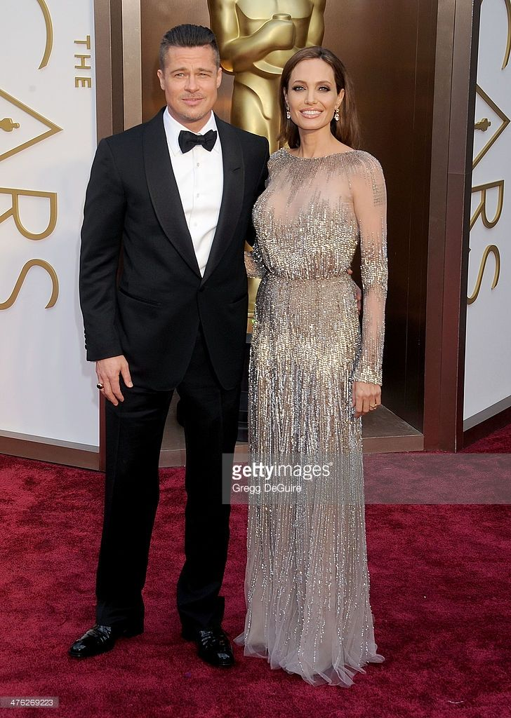 Actors Brad Pitt and Angelina Jolie arrive at the 86th Annual Academy Awards at Hollywood & Highland Center on March 2, 2014 in Hollywood, California.