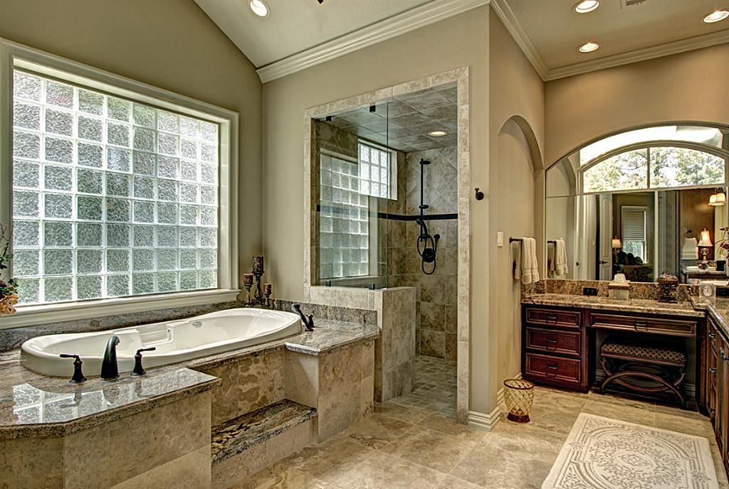 Over-sized tumbled tile shower for two with hand-held Groehe shower ...