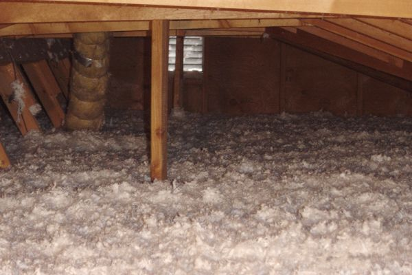 Saving Energy Blown In Insulation In The Attic Finished Attic Blown In Insulation Attic Ventilation