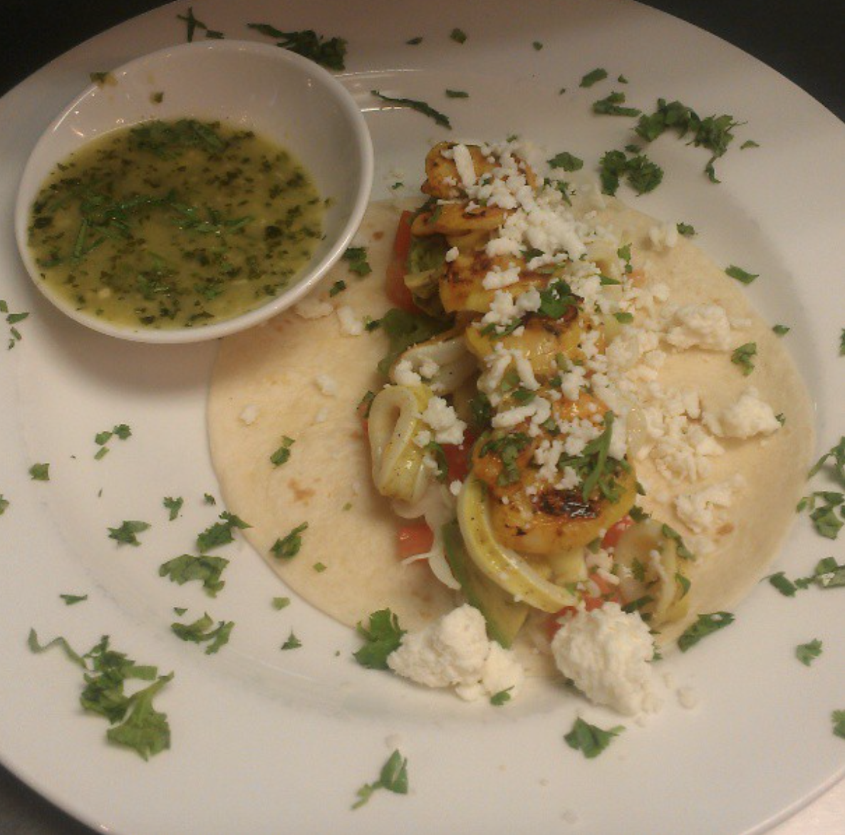 Thai Seafood Taco With Fresh Cilantro And Feta Cheese A Dipping Sauce
