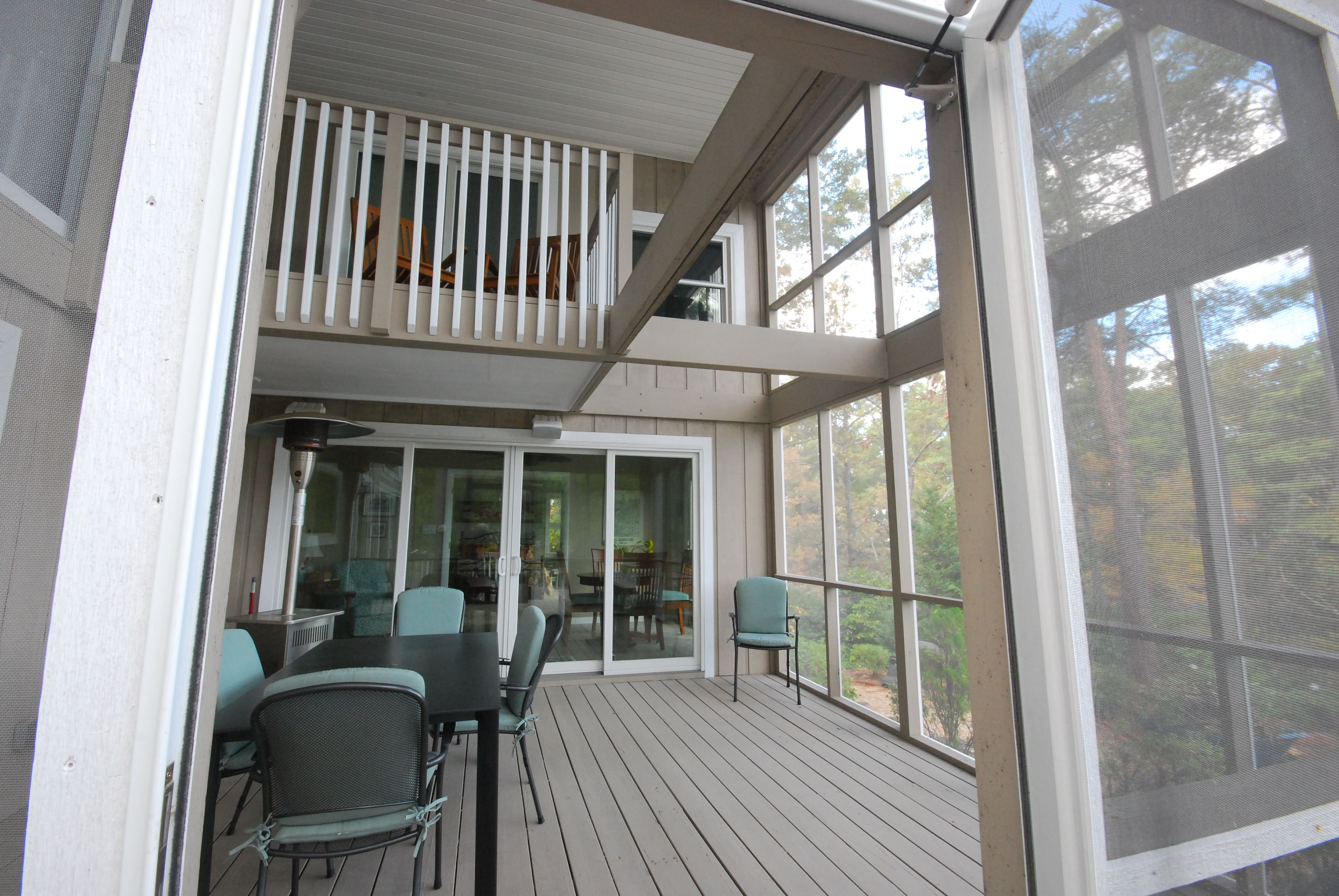 This screened porch has an enclosed second floor balcony