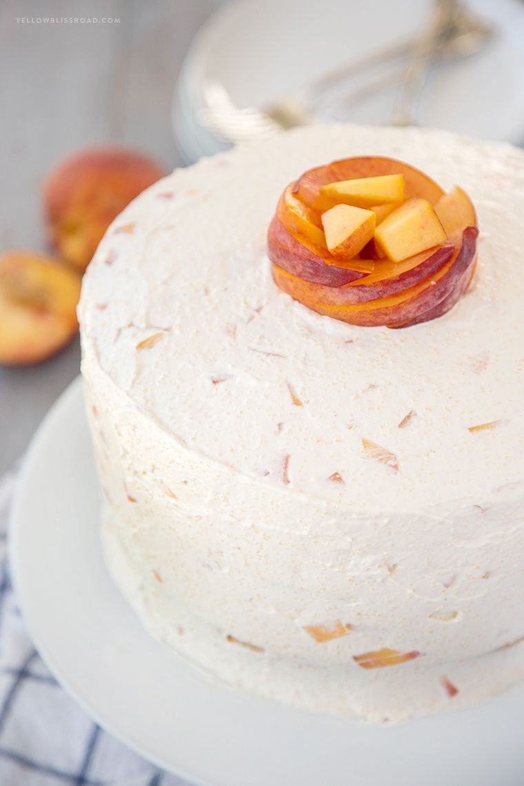Vanilla Layer Cake with Peaches and Whipped Cream Frosting #peachcake